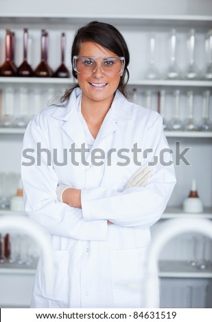 Portrait of a female science student posing in a laboratory - stock photo