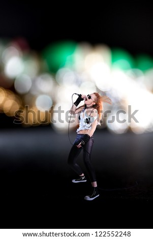 Portrait of a female singer - stock photo