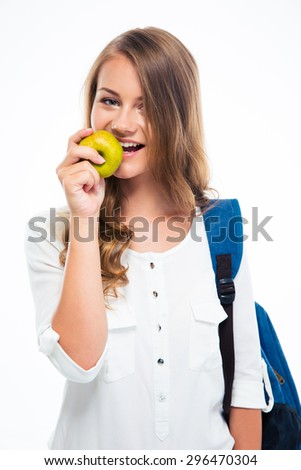 Portrait of a female student with backpack and apple isolated on a white background. Looking at camera - stock photo