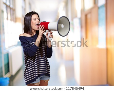 Portrait Of A Female With Megaphone, Indoor - stock photo
