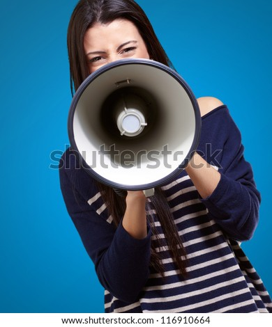 Portrait Of A Female With Megaphone On Blue Background