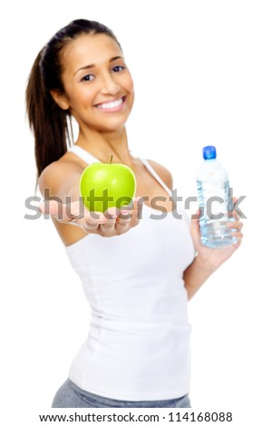 Portrait of a fit and healthy woman with bottle of water and green apple as a snack, isolated on white background - stock photo