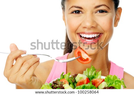 Portrait of a fit healthy hispanic woman eating a fresh salad isolated on white - stock photo