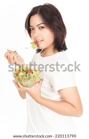 Portrait of a fit healthy hispanic woman eating a fresh salad isolated on white