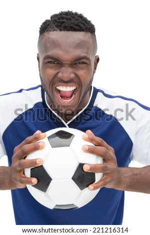 Portrait of a football player shouting over white background - stock photo