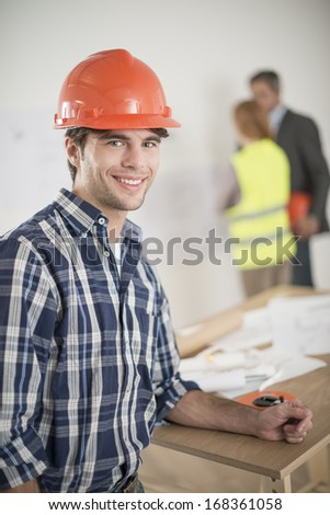 portrait of a foreman during a meeting about a build project - stock photo