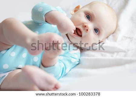 Portrait of a four months old baby - stock photo