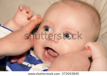 Portrait of a four months old baby boy  caucasian happiness and beauty, family - stock photo