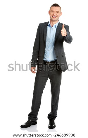 Portrait of a friendly businessman gesturing thumbs up - stock photo