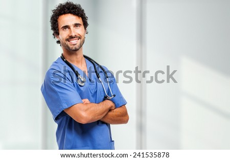 Portrait of a friendly doctor smiling  - stock photo