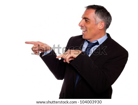 Portrait of a friendly hispanic businessman pointing to the right against white background - stock photo