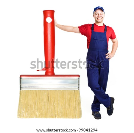 Portrait of a friendly painter leaning on a big brush - stock photo