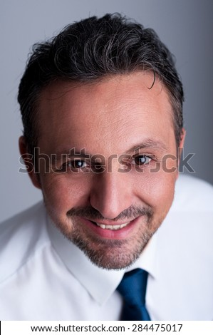 Portrait of a friendly, reliable and successful business man wearing white shirt and blue tie or necktie