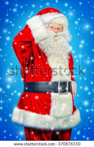 Portrait of a friendly traditional Santa Claus. Studio shot over blue background. Christmas. - stock photo