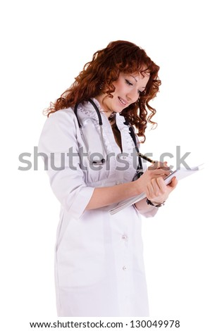 Portrait of a friendly woman doctor. Isolated over white background. - stock photo