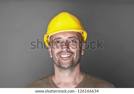 Portrait of a friendly worker - stock photo