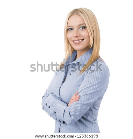Portrait of a friendly young businesswoman with crossed hands isolated on white background