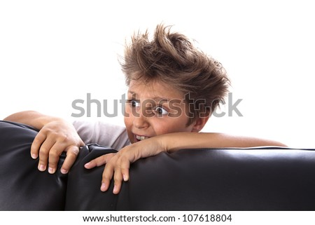 Portrait of a frightened boy - stock photo