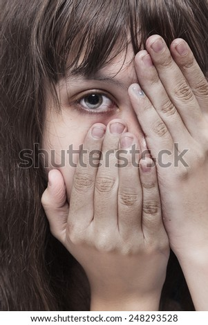 Portrait of a frightened girl, close-up - stock photo