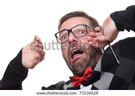 Portrait of a frightened nerd. Isolated against white. - stock photo