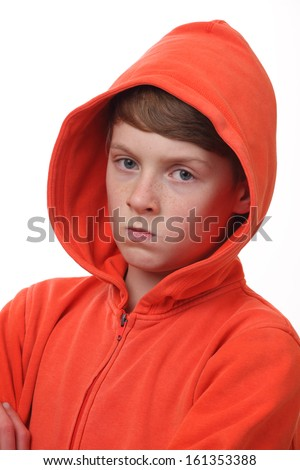 Portrait of a frustrated young boy on white background - stock photo