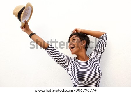 Portrait of a fun african american girl cheering with arms raised - stock photo