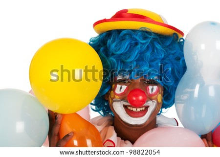 Portrait of a funny black clown with balloons
