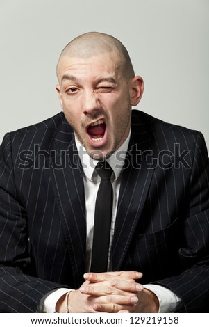 portrait of a funny businessman, isolated on gray background - stock photo