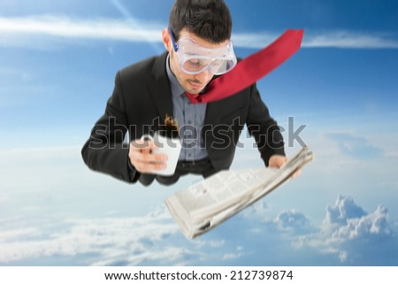 Portrait of a funny businessman skydiving while reading a newspaper - stock photo