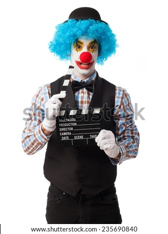 portrait of a funny clown holding a clapper