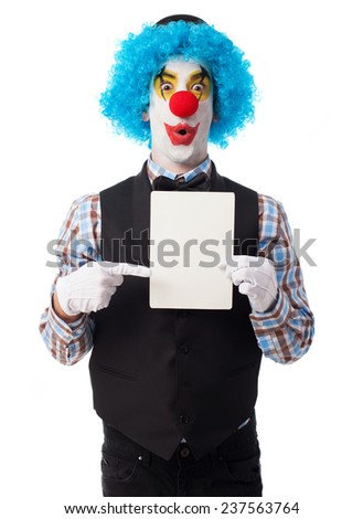 portrait of a funny clown showing a paper - stock photo