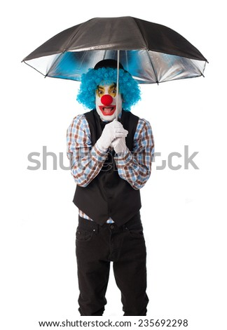 portrait of a funny clown with an umbrella - stock photo