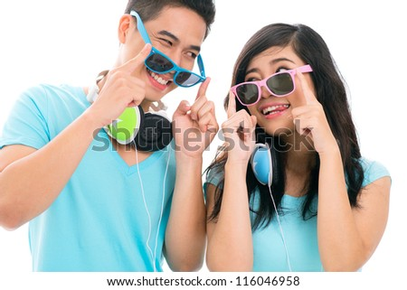 Portrait of a funny couple making faces to each other - stock photo