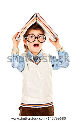 Portrait of a funny cute boy in huge glasses holding  books on his head. Isolated over white. - stock photo