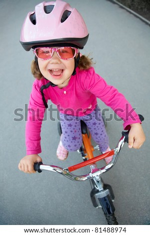 portrait of a funny girl with a bicycle - stock photo
