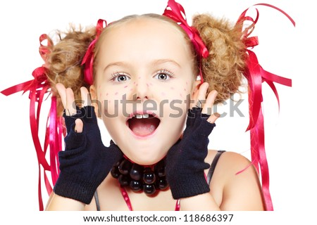Portrait of a funny girl with festive make-up, hairstyle and dress.