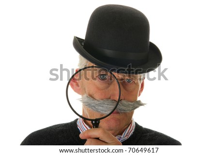 Portrait of a funny inspector with a big magnifier for investigation