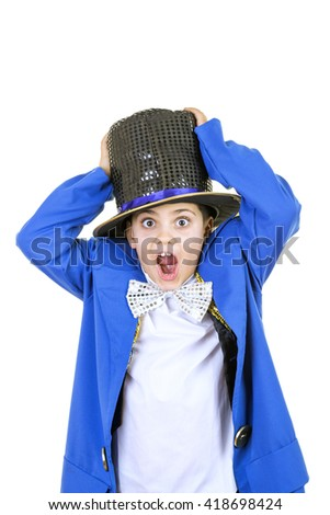 Portrait of a funny little boy in mad hatter costume while smiling to the camera against isolated white background. - stock photo