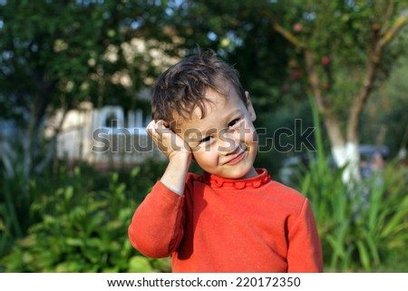 portrait of a funny little boy 4 year old outdoors - stock photo