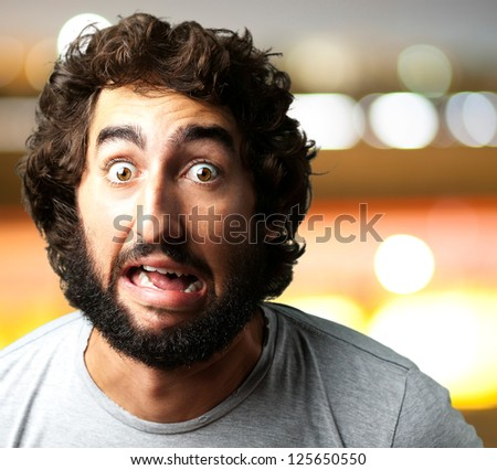 Portrait Of A Funny Man against a city by night background - stock photo