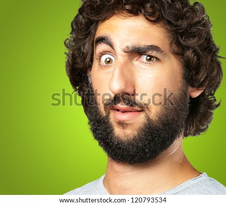 Portrait Of A Funny Man against a green background - stock photo