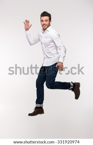 Portrait of a funny man jumping isolated on a white background - stock photo