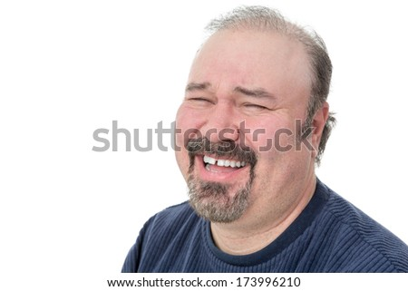 Portrait of a funny mature man laughing hard on a white background - stock photo