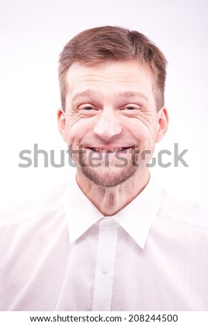 Portrait of a funny smiling man - stock photo