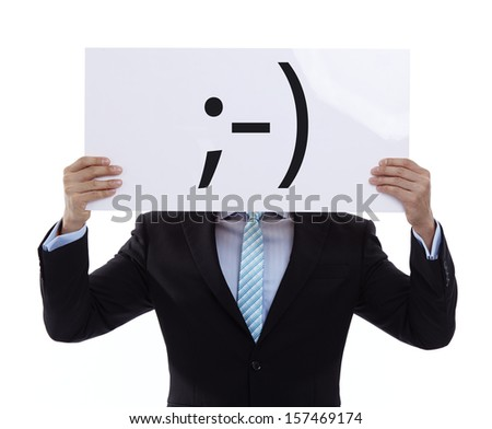 Portrait of a funny winking businessman on white background