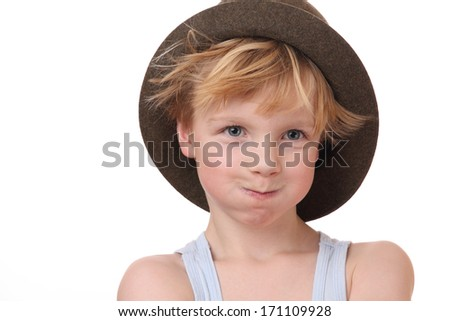 Portrait of a funny young boy with hat on white background - stock photo