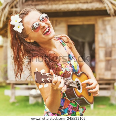"portrait of a funny young woman playing ukulele (""instagram"" filter applied) - stock photo"