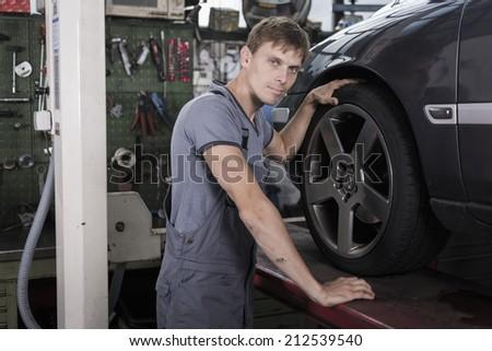 Portrait of a garage holder - stock photo