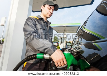 Portrait of a gas station worker