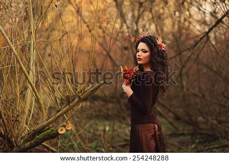 portrait of a gentle girl in beautiful park - stock photo